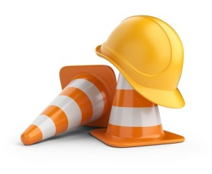 Two construction cones and a hard hat
